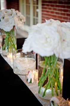 White Flower table top arrangements (we can order these cylinder jars from Ikea, they're like a buck each if you don't want to do the mason jar idea.  Or we can ROAD TRIP! to Ikea...lmao)