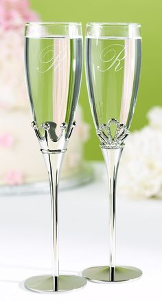 """Nickel-plated stems adorn these wedding champagne flutes decorated with rhinestone studded crowns fit for a King and a Queen. 10 1/4"""" tall. Set of two."""
