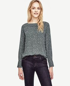 """Prettily perforated at the neckline, this versatile top pairs crisp texture with a fluid silhouette. Boatneck. Long sleeves with button closure. Back keyhole with hook-and-eye closure. Shirttail hem. Front and back perforated lace trim below neck seam. 26"""" long."""