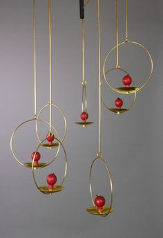 Finnish Brass Mobile Candelholder by Kaija Aarikka | From a unique collection of antique and modern chandeliers and pendants  at https://www.1stdibs.com/furniture/lighting/chandeliers-pendant-lights/