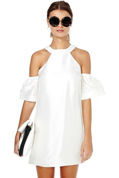 This lightweight silk dress is perfect for graduations, summer parties or weekend adventures! It features a cutaway neckline with off-the-shoulder sleeves and double button closures at back above cutout.
