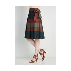 While reflecting on your day, you excitedly make note of your outfit, which features this striped midi skirt.  Waxing poetic about the cocoa, midnight blue, bu…