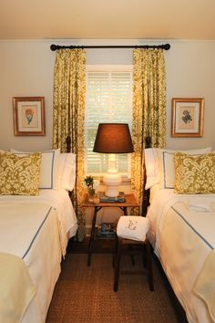 guest room with two cute beds made up the same way