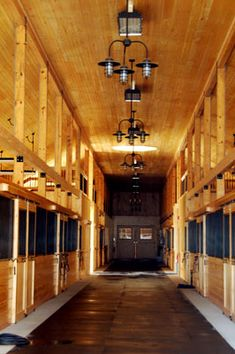 LOVE the chandelier type lights in the barn plus lights in each stall. Sliding doors or swinging doors would work here