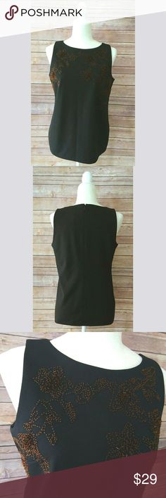 Ann Taylor black beaded sleeveless top. NWT Ann Taylor black top new with tags.  It has a design on the front with copper tone beads.  It is a sleeveless top and it has a zipper on the back. Ann Taylor Tops
