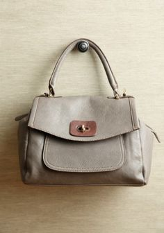 Cute Shoulder Purse - Gray Leatherette. This has a military-style look with a sophisticated edge!