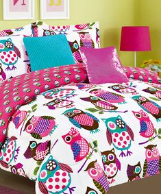 Night owls love this charming bedding set that updates décor with its adorable pattern and vibrant hues. Crafted from soft materials, this chic ensemble includes a comforter, shams and decorative pillows to create a cohesive look.