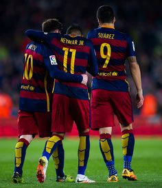 Neymar Santos Jr of FC Barcelona is congratulated by his teammates Luis Suarez and Lionel Messi after scoring his team's fifth goal during the La...