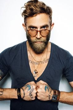 God I want a beard like that someday. And I wish I could get tats on my hands and forearms :/