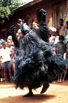 "Africa | The mask Muma (""We Agree"" or ""Unity""), carved by Ado Dassama, dancing at Ngiyehun, Luawa, Kailahun, Sierra Leone. | ©Ruth Phillips."