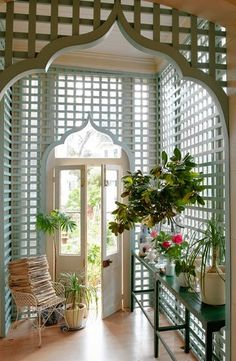 """Trellised garden room in Sara Ruffin Costello's New Orleans home. Interior design by Sara Ruffin Costello. Photography by Paul Costello for The Wall Street Journal. """"Bring the Garden Inside With a Trellis Room""""  The Wall Street Journal (May 11, 2013)."""