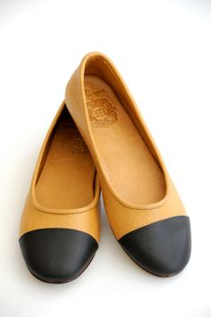 Cap toe leather flats in a range of appealing hues. $110.00.