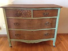 Saw on Craigslist: unique solid wood antique dresser. The top and drawers are tiger wood and have been stain dark walnut. The top left drawer has a stained flower design. The body of the dresser is painted a beautiful green with milk paint and distressed for a shabby chic look. It also has wood casters.