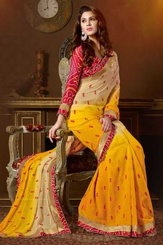 Cream and yellow chiffon saree with maroon satin blouse.Embellished with embroidered, resham, zari and stone.Saree comes with u neck blouse.It is perfect for casual wear, festival wear, party wear and wedding wear.Andaaz Fashion is the most popular designer wear online ethnic shop brands. Price :  $76.57 http://www.andaazfashion.us/womens/sarees/work/embroidered-saree