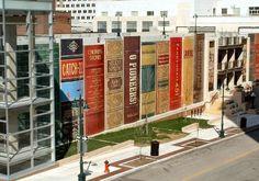 Community bookshelf of 25-foot-tall book spines