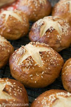 Soft Honey Sesame Pretzel Rolls - It's easy to make these delicious soft honey sesame pretzel rolls at home!