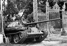 A NVA T-54 smashes through the gates of the Presidential Palace in Saigon, marking the fall of South Vietnam to Communist forces, 30 April 1975.