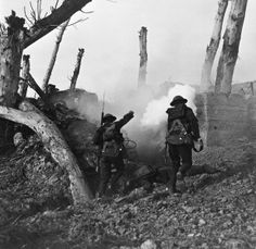 Two United States soldiers storm a bunker past the bodies of two German soldiers during World War I. Digitally restored.