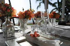 Assorted silver mercury vases. Dinnerware. Silver square charger plates. Linens. Silver mercury votives. Private dinner following the Maui wedding ceremony  #TadCraigPhotography #Dellables #HawaiiWeddingsbyToriRogers #OrangeFlowers http://www.hawaiianweddings.net
