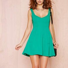 """Green skater This structured dress features ribbed fabric, a V neckline, pockets at front, and a fitted waist--all in an unstoppable shade of shamrock green. Zip/hook closure at back, fully lined. Throw it on with a moto jacket and pumps for the perfect day-to-night look!  *31""""/79cm length  *30""""/76cm bust  *Model is wearing size small  *Measurements taken from size small  *Hand wash cold Dresses"""