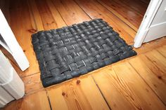 Handamade upcycled recycled ]tire doormat by Tirebelt.com. $29.00 via Etsy.