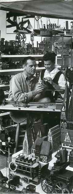 Charles and Ray Eames at work on TOCCATA FOR TOY TRAINS