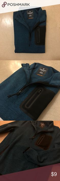 American Eagle Active Quarter ZIP Sweatshirt THE SECOND PIC IS MOST ACCURATE FOR COLOR!   American Eagle Men's Active Quarter zip sweatshirt in teal. AMAZING for an active look or just trying to stay trendy, hidden pouch pocket in the front and thumb holes for ease of use! American Eagle Outfitters Sweaters Zip Up