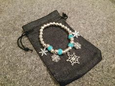 Time to get Christmassy! With a Christmas Snowflake Bracelet with silver plated balls and beautiful blue murano glass beads - awesome !