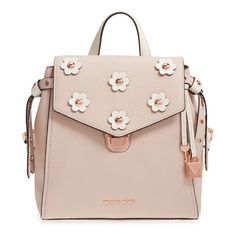 Contrast flower appliques centered by polished dome studs punctuate the flap of a boxy little backpack. A convenient magnetic back pocket makes a...