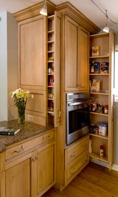 Inspiration Storage. Clever And Smart Hidden Storage Cabinetry Design Ideas: Amazing Natural Oak Kitchen Cabinetry Set With Pull Out Hidden Storage For Kitchen Herbs Place And Microwave Storage As Well As Brown Mosaic Granite Countertop Design Ideas
