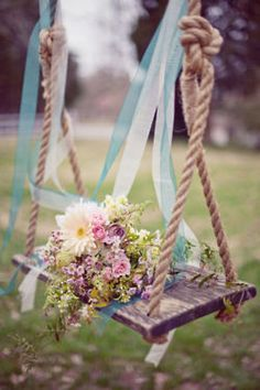 A rustic wooden swing, tons of ribbons, maybe some bubbles. Yep its a photo shoot.