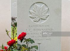Roses by the grave of Private James Charles Townsend of the Royal Regiment of Canada, R.C.I.C., at the Canadian War Cemetery near Dieppe, France, 19 August 2013, on the 73rd anniversary of the Dieppe raid. More than 6000 allied troops, mostly Canadians, landed on 19 August 1942. At the end of the day, after a fierce battle, the Allies had 1550 dead and some 2400 prisoners. 948 Commonwealth servicemen of WWII are buried or commemorated in this cemetery.