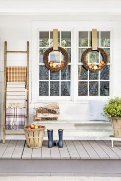 Spruce up your entry with these simple, seasonal, use-what-you-have ideas. If you have a wooden ladder: Display a cozy blanket on each rung. If you have a grapevine wreath: Dress it (or a pair) up by nesting nuts and apples in the lower half, then hang with 3-inch-wide burlap ribbon. If you have a bushel basket: Repurpose it as a rustic planter.