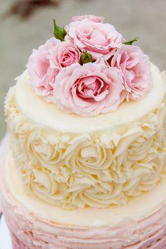 Soft and feminine wedding cake with rosettes and ruffles