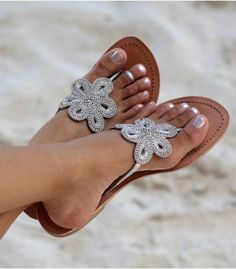 The Bari Leather Sandal is an elegant beaded flower design on a nautral leather base. The crystal beads add glamour to any wardrobe, day or night.       Hand made in India    Genuine Leather Upper, with contrast white stitching    Flat Leather Sole, with very small non slip heel