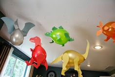 Dinosaur Balloons - just need balloons, tape, scissors and colored paper!
