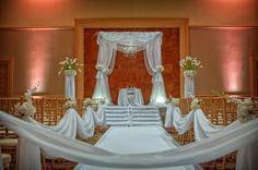 White satin draped chuppah found on Modern Jewish Wedding Blog // Jeff Kolodny Photography, Inc.