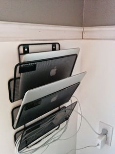 So my wife and I were tired of cleaning the kitchen only to see a pile of wires and laptops on the table. This handy trick is quick and easy. The best part? Cheap too. Buy a regular wall-mounted office organizer (something sturdy) and use it to store cables and devices alike next to your favourite spot in the house. Before you know it, voila, you have a wall mounted laptop rack!