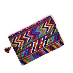 Artisan made fun clutch with up-cycled Mayan fabric. Handmade,  one of a kind, perfect gift idea for her. Christmas gift, birthday gift, artisan made, fair trade, ethically made, sustainable fashion, slow fashion, ethical fashion. Guatemala, boho chic, boho bag, ethnic, folklore,  street style.