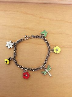Spring Charm Bracelet/Dragonfly Bee Butterfly and Flowers charms/All things spring jewelry/Handmade and Unique/Fun gift idea/Charm Bracelet by JemsmadeBeautiful on Etsy