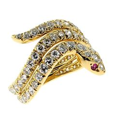 Cartier Ruby Diamond Gold Snake Ring | From a unique collection of vintage band rings at https://www.1stdibs.com/jewelry/rings/band-rings/