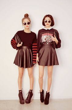 Dark street style look with the graphic sweaters, black pleather skirts, and black heels.