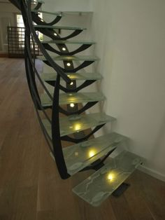 Very organic steel and glass stair. The central spine even has lights in it.