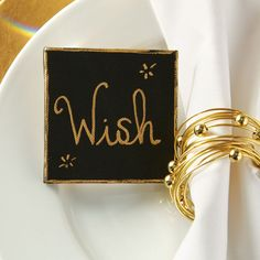 Add an elegant DIY touch to your gorgeous tablescape with easy mini black and gold calligraphy canvas place settings