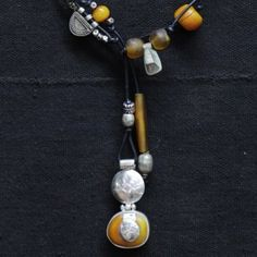 Amber and sterling silver Tuareg amulet, antique Ethiopian telsum, amber beads from Mali.