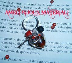 anello con cuore in vetro murano e charms argentati
