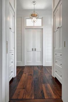 The bright window draws my attention which then connects to the chandelier then the door then to the hard wood floor.