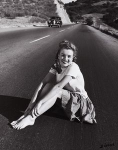 Marilyn Monroe at 19 years old sitting in the middle of the Pacific Coast Highway, California. USA, 1945.