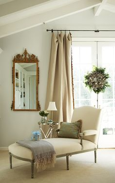 Traditional reading nook: Lounge with fluted legs, gold mirror, long flowing draperies...