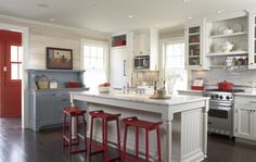 Pretty white kitchen with touches of grey/blue and red